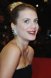 Melaine Laurent's pulled back hair allowed her elegant decorative earrings to shine on the red carpet.