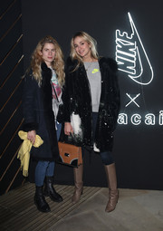 Elisabeth von Thurn und Taxis jazzed up her casual look with a printed coat for the NikeLab x Sacai launch.