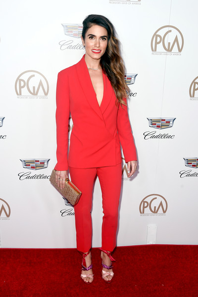 Nikki Reed Studded Clutch [clothing,red carpet,suit,red,carpet,pantsuit,formal wear,fashion,outerwear,shoulder,arrivals,nikki reed,the beverly hilton hotel,beverly hills,california,annual producers guild awards]