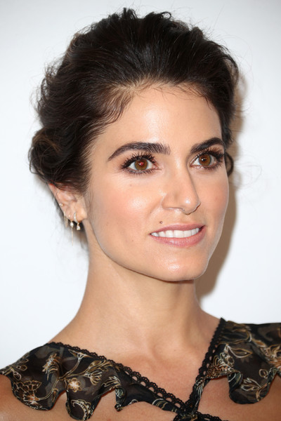 Nikki Reed Loose Bun [hair,face,eyebrow,hairstyle,beauty,chin,shoulder,lip,skin,black hair,variety,power of women,los angeles,beverly hills,california,beverly wilshire four seasons hotel,nikki reed,arrivals]