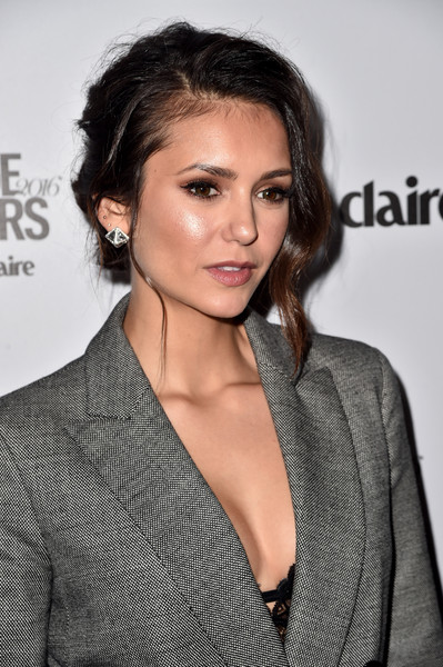 Nina Dobrev Messy Updo [hair,hairstyle,eyebrow,lip,beauty,brown hair,chin,long hair,black hair,premiere,arrivals,nina dobrev,marie claire,marie claires image maker awards,california,los angeles,chateau marmont]