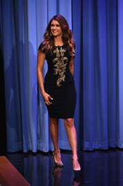 Nina Dobrev continued the gold and black motif with a pair of glamorous, glittery Brian Atwood pumps.