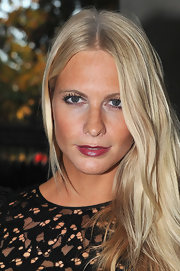 Poppy Delevigne wore a pretty berry stain on her lips topped with a little gloss at the Nina Ricci ready-to-wear Spring/Summer 2012 fashion show. To try her sexy look, we recommend Covergirl Outlast All-Day Lipcolor in a shade like Timeless Ruby.