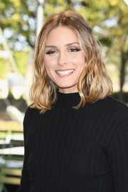 Olivia Palermo wore her hair in half-up waves at the Nina Ricci Spring 2018 show.