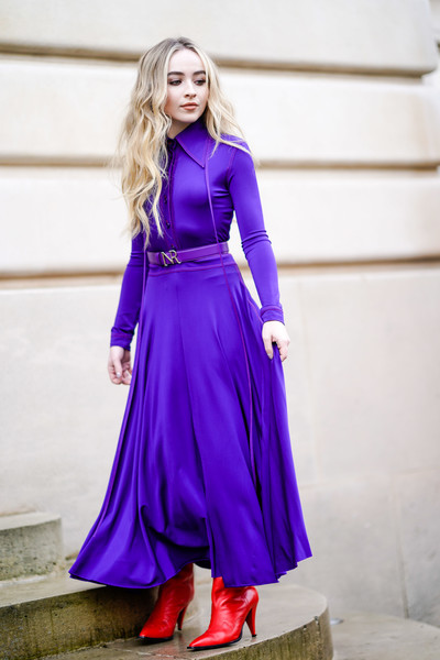 Sabrina Carpenter went for a bold color pairing with this purple maxi shirtdress and red boots combo at the Nina Ricci Fall 2018 show.