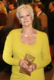 Subtle smoky shadow definitely accentuated Judi Dench's bluish grey eyes.