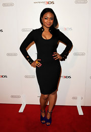Tatyana Ali spiced up her look with purple suede peep toes with ankle straps.
