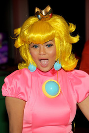 Chrissy Teigen looked very colorful in a yellow wig, a pink dress, and blue earrings during her birthday party.
