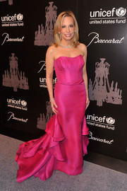 Gillian Miniter Sylvester was a total charmer at the UNICEF Snowflake Ball in a strapless fuchsia corset gown with a ruffled train.