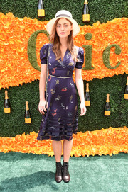Phoebe Tonkin paired her cute dress with vintage-chic lace-up boots.