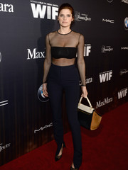 Lake Bell teamed her sexy mesh top with high-waisted navy pinstripe pants.