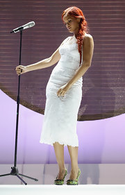Rihanna teamed her feminine white lace dress with floral pumps.