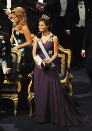 Crown Princess Victoria looked stunning in a sleeveless purple evening dress with a V neckline and a gathered skirt.