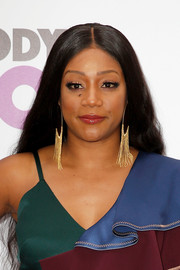 Tiffany Haddish went for bold styling with a pair of gold chandelier earrings.