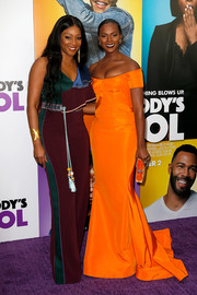 Tika Sumpter looked absolutely dazzling in an orange off-the-shoulder gown by Zac Posen at the New York premiere of 'Nobody's Fool.'