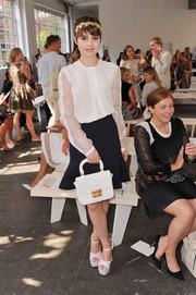 Sami Gayle looked very dainty in her delicate white blouse during the Nonoo fashion show.