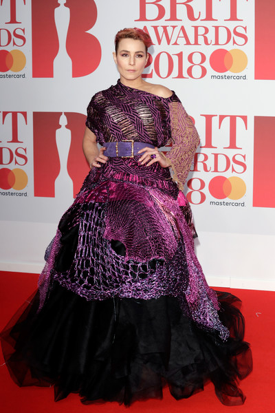 Noomi Rapace Off-the-Shoulder Dress [flooring,carpet,fashion,red carpet,gown,dress,fashion model,magenta,girl,fashion design,red carpet arrivals,noomi rapace,brit awards,relation,the o2 arena,england,london]