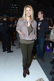 Alex McCord looked casual in forest green skinny pants while attending the Noon by Noon runway show.