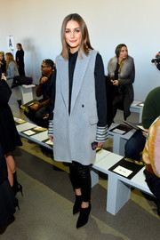 Olivia Palermo teamed a long fuzzy vest with a button-down and leather pants for the Noon by Noor fashion show.