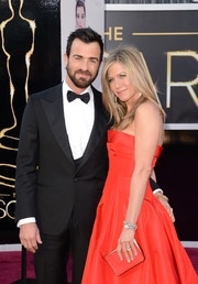 Jennifer Aniston looked radiant in red at the 2013 Oscars. Her elegant box clutch is by Salvatore Ferragamo.