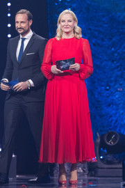Princess Mette-Marit stood out onstage in a red tea-length dress while attending a sports gala.