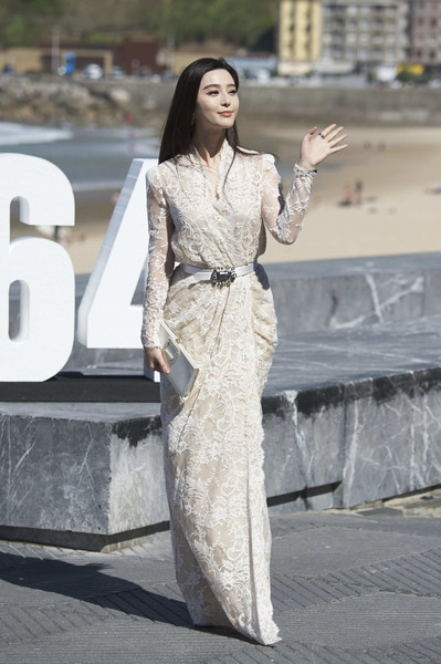 Fan Bingbing looked stunning in a cream-colored lace wrap gown by Alexander McQueen at the San Sebastian Film Fest photocall for 'I Am Not Madame Bovary.' It was just a photocall but the dress was definitely premiere-worthy!