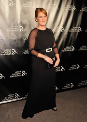 Sarah Ferguson came in at thee Novak Djokovic Inaugural Dinner wearing a long sheer-sleeved gown.