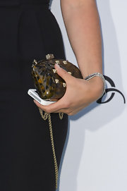Tamara carried an itty bitty calico-colored, hard-case clutch to the Novak Djokovic Foundation Dinner.