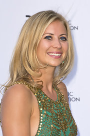 Holly Branson kept her evening look classic and elegant with a sleek and straight, layered chop.