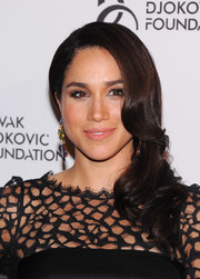Meghan Markle wore an Old Hollywood-glam side sweep at the Novak Djokovic Foundation dinner.