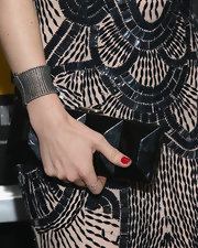 Isla's geometric-shaped black clutch had a cool edgy feel to it when paired with her Art Deco-inspired dress.
