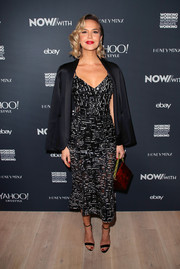 Arielle Kebbel completed her outfit with black ankle-strap sandals by Schutz.