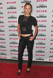 Estella wore black, low-rise skinny jeans with peep toe pumps.
