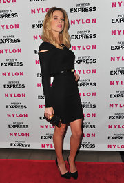 Amber Heard showed paired her black dress with a hard case embellished black clutch.