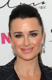 Kyle Richards gave her look a shimmering touch with smoky shadow. She lined her lower lid with white liner to look more awake.