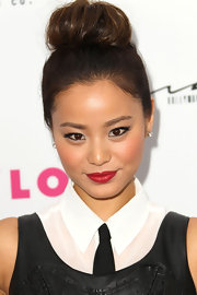 Jaime Chung paired her classic ballerina bun with vivid red lipstick. Sleek liner around her lids completed her alluring look.