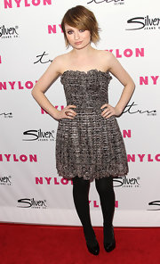Emily Browning teamed her strapless tweed dress with black patent pumps.