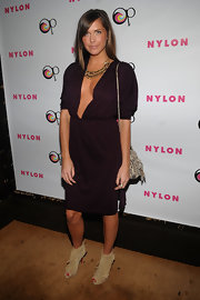 Erin was daring at the Nylon party in a maroon knit cocktail dress with a deep plunge.