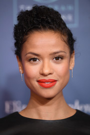 Gugu Mbatha-Raw accessorized with simple silver dangle earrings.