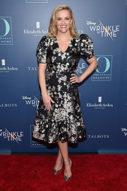 Reese Witherspoon complemented her dress with silver ankle-strap pumps by Jimmy Choo.