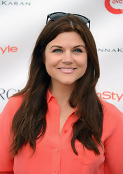 Tiffani Thiessen left her hair down in  trendy layers when she attended OCRF's Super Saturday.