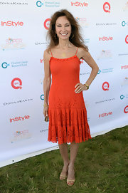 Susan Lucci kept her look casual with a crocheted dress in a bold tangerine hue.