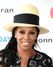 June Ambrose attended OCRFA's Super Saturday rocking an oversized straw bowler hat.