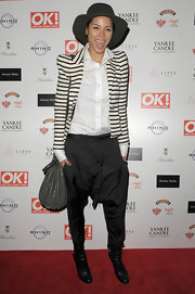 Ana Araujo rocked a pair of black harem pants at the OK! Magazine Christmas party.