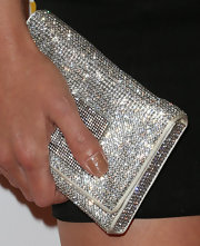 Jessica Sutta carried a glam stone-studded purse at the OK Magazine pre-Grammy party.