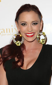 Jessica Sutta had her tresses mildly curled and tied in a loose ponytail at a party hosted by OK Magazine.