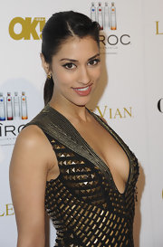 Janina Gavankar attended the 'OK!' magazine pre-Oscar party wearing her hair twisted back and secured in a low sleek ponytail.
