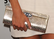 Giuliana carried an Egyptian eye snakeskin clutch to the Ok Magazine party.