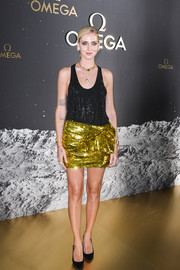 Chiara Ferragni teamed her top with a metallic gold mini skirt.