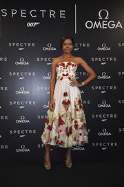 Naomie Harris donned a strapless floral white dress to the OMEGA SPECTRE Japan release